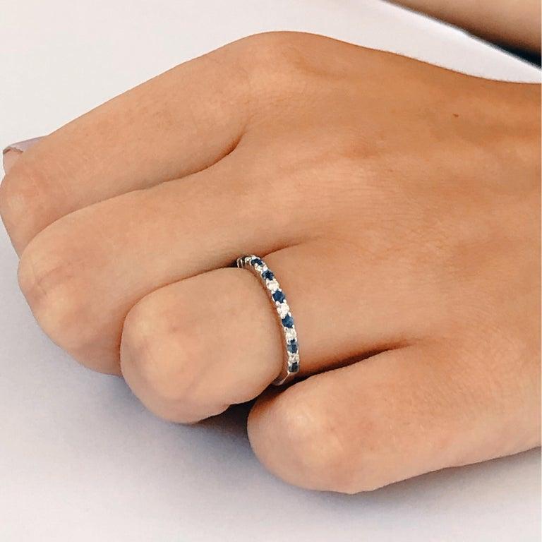 Eighteen karat white gold partial thirteen stone ring  Diamond weighing 0.27 carat  Sapphire weighing 0.50 carat Diamond quality G VS New Ring Ring size 6 In Stock Ring can be resized
