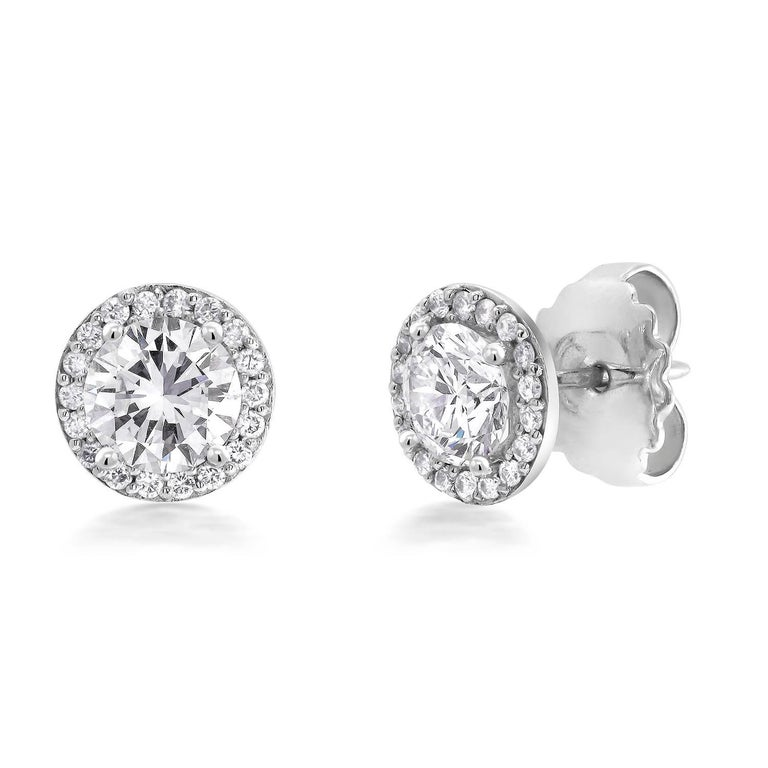 Featuring 18k white gold halo diamond earrings with pave-set diamond custom order ready for your old stud diamond earrings Earrings are available for pairs from 0.50 to 2 carat center stones Center stones not included Diamond weight 0.45