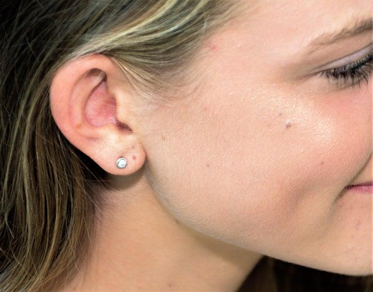 Contemporary Round Diamond 0.24 Carat Bezel Set Stud Earrings For Sale