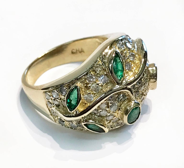 Vintage Emerald and Diamond 14K Yellow Gold Cocktail Ring, Bezel/Pave. A golden vine with Emerald leaves, bezel set, 0.64 carat adore this ring, the five Emeralds are marquise, oval and round. Seventy-eight (78) pavé set Diamonds (1.56 carat) add to