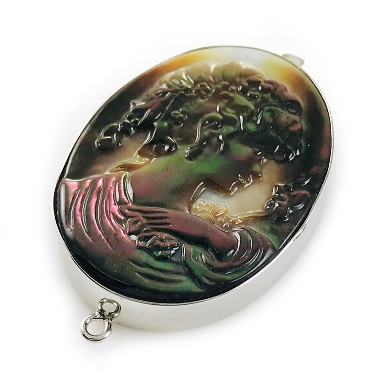 Sterling Silver Black Mother-of-Pearl Cameo Brooch Pendant. Portrait of a lady in profile. Beautifully carved by an artisan in Italy. The size of brooch pendant is approximately 0mm x 0mm. Could be worn as a brooch or a pendant on a chain.
