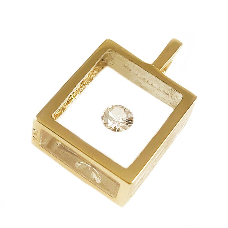 Incogem Floating Solitaire Diamond Pendant: 14k Yellow Gold. The pendants are handcrafted of recycled 14k yellow gold. The diamond is brilliant cut, 58 facets, VS1 in clarity (G.I.A.) and H in color (G.I.A.). Each diamond weighs 0.13 carat. The