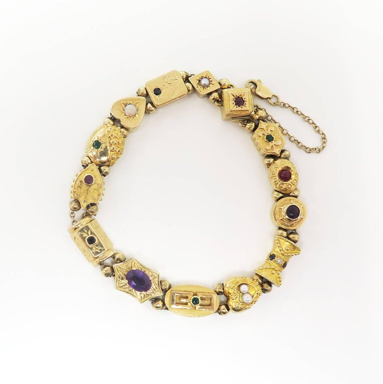 For a short time during the 1950s, nineteenth century Victorian style jewelry enjoyed a strong resurgence, and this classic slide bracelet is a striking example of the favored style. This 14 karat yellow gold bracelet is composed of 14 individual,