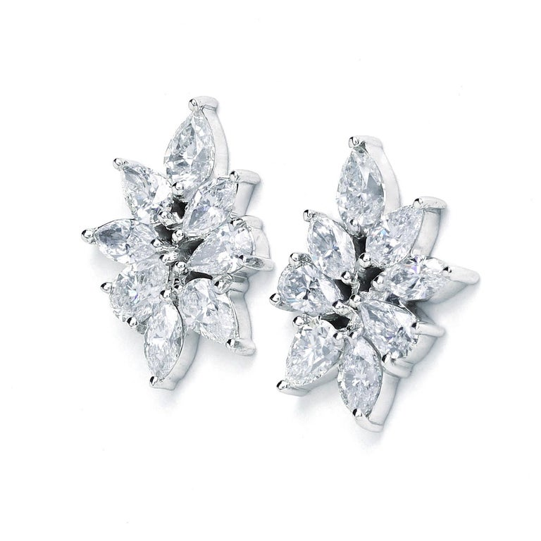 These New York Jewelers earrings are made of 14K white gold. It contains pear G-H color, SI clarity diamonds weighing 5.39 CTTW, marquise G-H color and SI clarity diamonds weighing 2.40 CTTW.