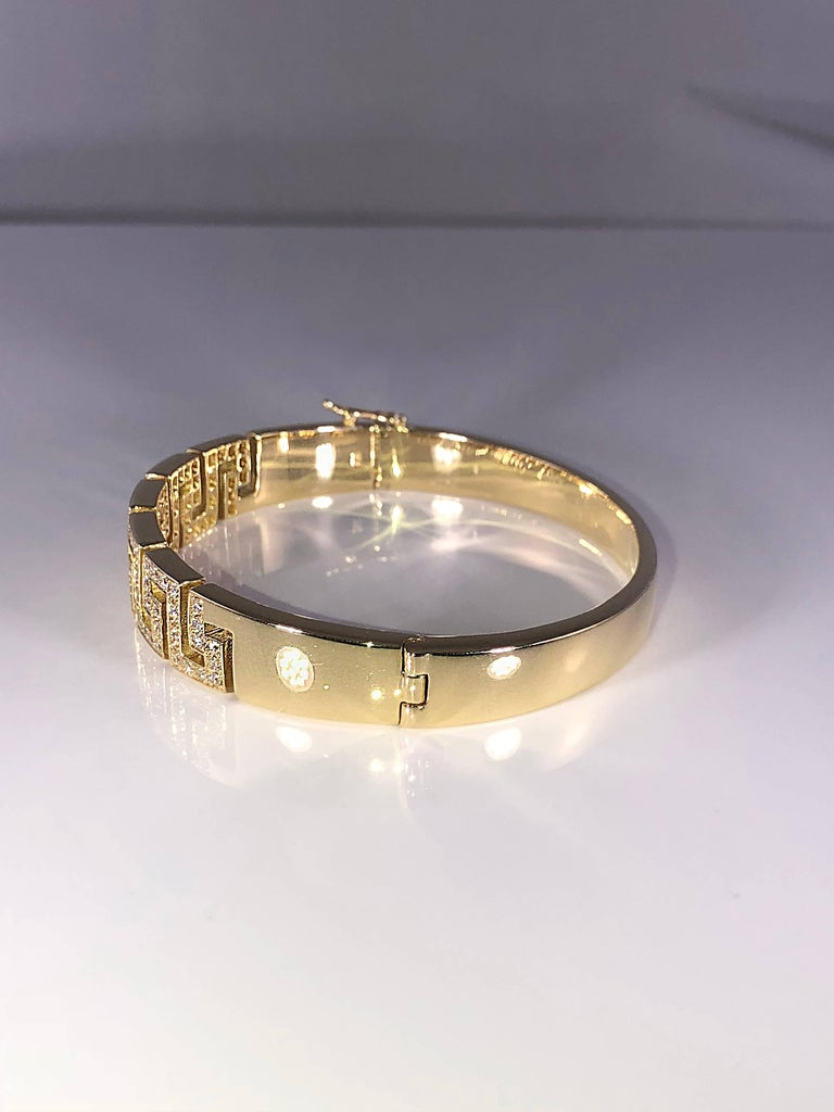 S.Georgios designer bracelet in solid yellow gold 18 karat all handmade with the Greek Key design, the symbol of eternal life. The Bracelet is custom made and has brilliant cut diamonds total weight of 1.02 Carat and a second security clasp on the