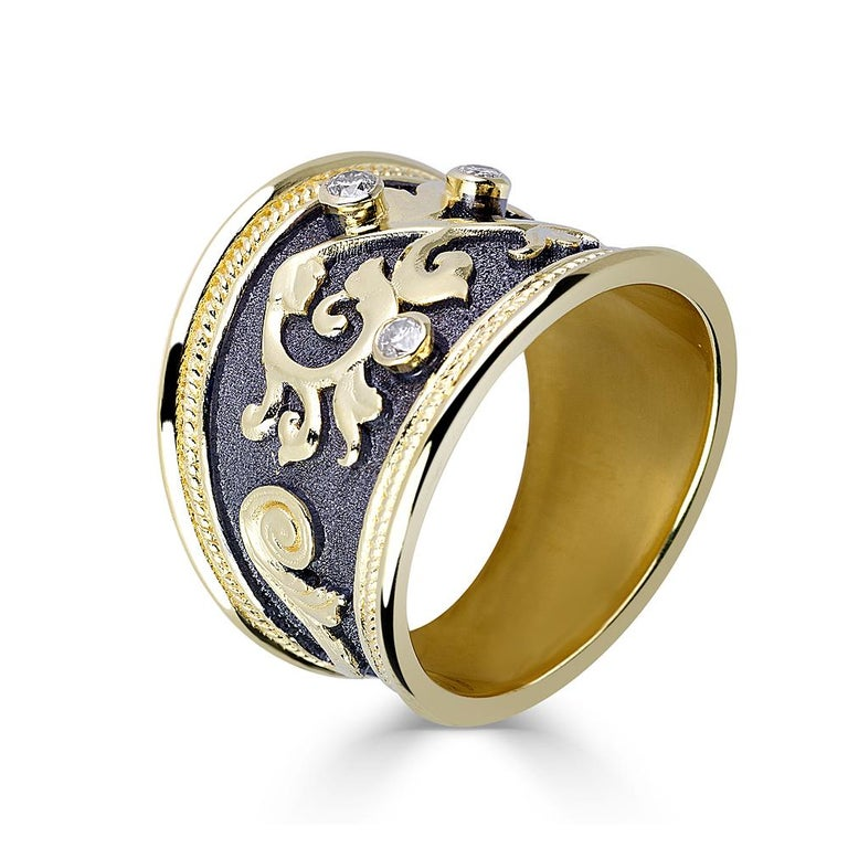 S.Georgios design ring handmade from solid 18 Karat Yellow Gold. The ring is microscopically decorated with gold decorations. Granulated details contrast with Byzantine velvet background finished with Black Oxidized Rhodium. Ring features 3
