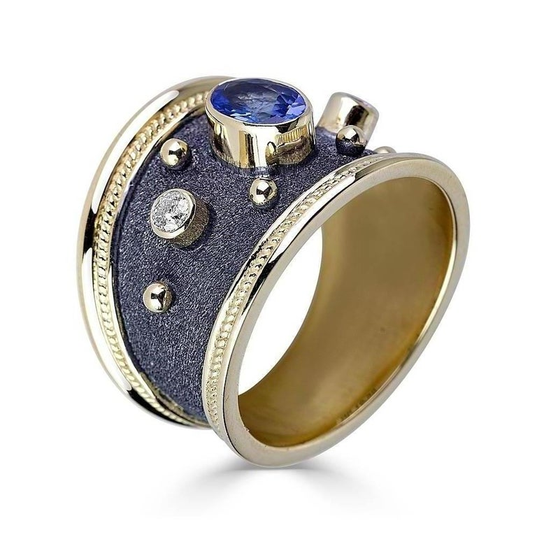 S.Georgios designer 18 Karat Solid Yellow Gold Ring all individually decorated with Byzantine granulation work and a unique velvet look on the background finished in Black Rhodium. This gorgeous ring features 2 Brilliant cut White Diamonds total