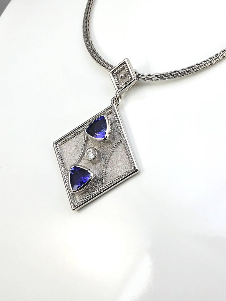 Trillion Cut Georgios Collections 18 Karat White Gold Pendant with a Diamond and Tanzanites For Sale