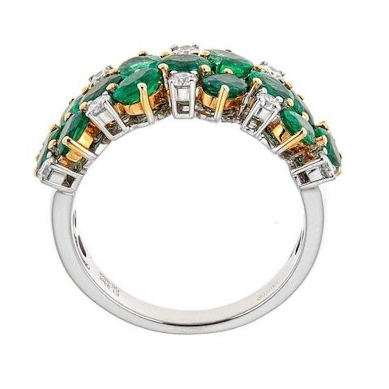 Handmade 18k white gold ring with approximately 1.93 CT in oval cut emeralds and approximately .35 CT in round cut diamonds.