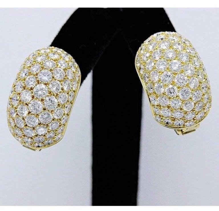 Van Cleef & Arpels  Pave Diamonds Huggie Earrings in 18KT Yellow Gold .   132 Round Brilliant Diamonds 13.50 TCW F color, VVS clarity.   Serial Number N.Y.61681 ..... Earrings are stamped 18K 750©VAN CLEEF & ARPELS N.Y.61681.