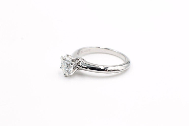 Tiffany & Co  Classic Six Prong Solitaire Engagement Ring in Platinum....  Round Brilliant Cut Diamond is a 1.02 CTS H color, VS1 Clarity.   Size 6 - sizable.   Diamond has crown inscription