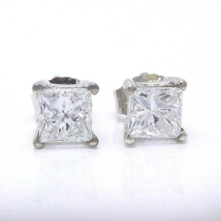 PRINCESS CUT DIAMOND STUD EARRINGS Serial Number:  UGS # US19933201D Metal:  14KT White Gold Backs:  Push Backs for Pierced Ears Total Carat Weight:  1.21 TCW Diamond Shape:  Princess Cut Diamond  Diamond Color & Clarity:  F - G / SI1 -