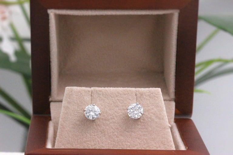 Round Cut Leo Diamond Stud Earrings Rounds 0.98 Carat F-G SI 14 Karat White Gold For Sale
