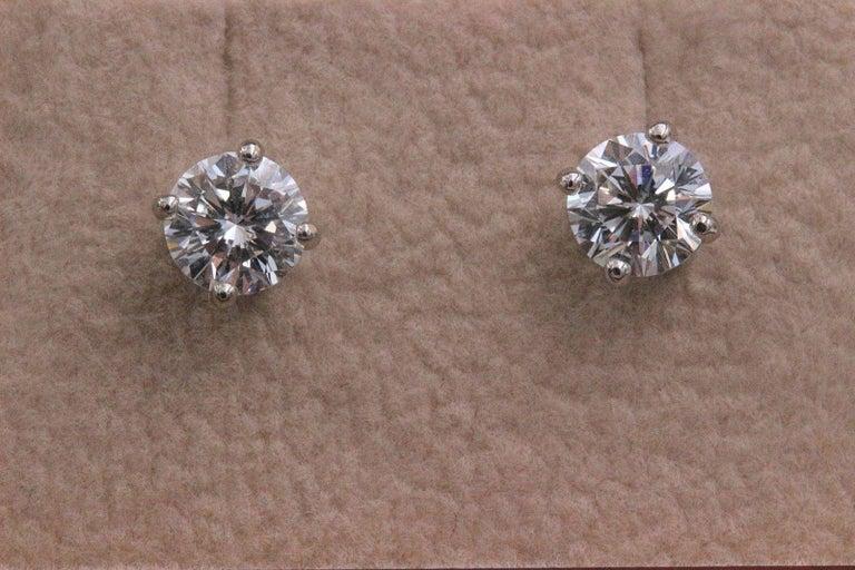 Leo Diamond Stud Earrings Rounds 0.98 Carat F-G SI 14 Karat White Gold For Sale 1