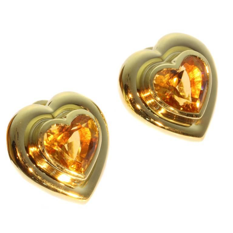 A pair of heart shaped clip on earrings by Paloma Picasso for Tiffany & Co c.1983 in 18 karat yellow gold, C 1983 V&Co signature and hallmarks, set with 2 heart shaped citrine stones. Dimensions: 0,98 inch x 0,98 inch. Weight 28,20 gram.