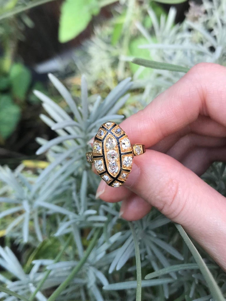 A 18th century ring in 18 karat yellow gold, black enamel, set with 15 old European cut diamonds totaling 1.50 carat (color and clarity: G/K, vs/i). Top of ring 0.75 inch x 0.47 inch. Ring size 5½, free resizing (only for extreme resizing we have to