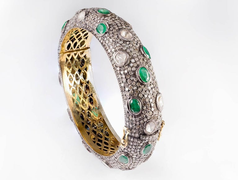 Rose Cut Brown and White Diamond of 8.80ct total weight and 11.00ct of Natural Emerald Oval Cut set on 925 Sterling Silver and 14kt gold Clamper Bracelet.
