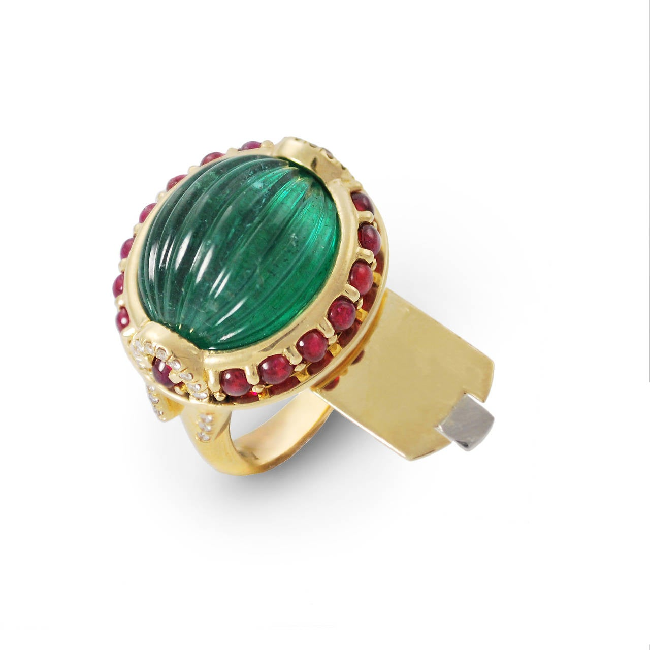 an emerald ruby and gold secret ring by