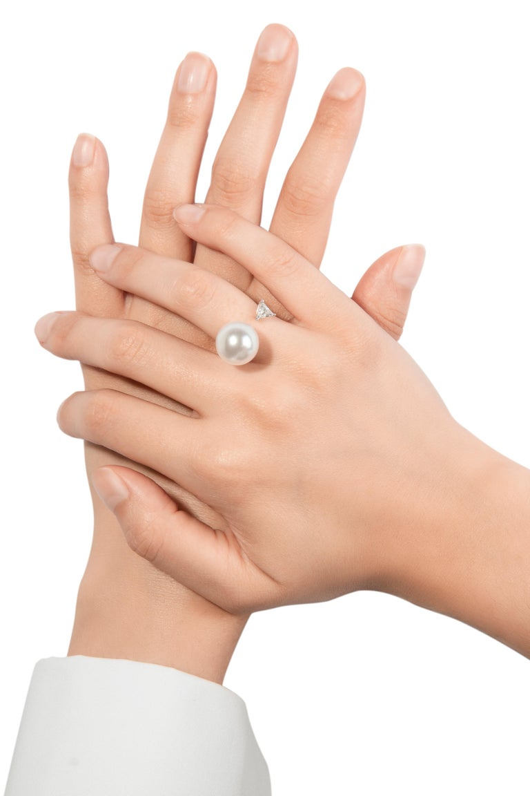 The Pearl and Diamond ring designed by Italian jeweller Delfina Delettrez is handcrafted in Rome from 2.15 gr 18 karat white gold and features one trillion diamond 0.32 ct and one large Australian pearl of 13mm. The open ring is designed to give the