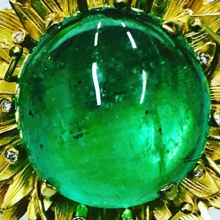 Sumptuous floral Colombian 10 carat cabochon emerald earrings set in 18 carat yellow gold with diamond details. Please note this item is made to order and a similar but not identical piece can be made. Allow four weeks to delivery.