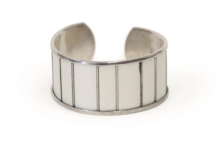 Sublime cuff bracelet in off-white enamel and silver. Designed by Grete Prytz Kittelsen for J. Tostrup from 1950s first half. The bracelet in is good vintage condition with a minor chip on the enamel (see picture). A very rare piece of Norwegian mid