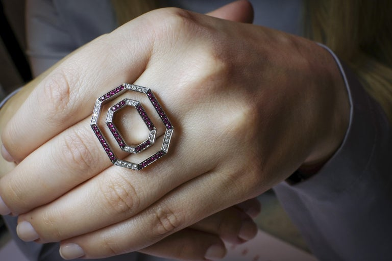 Crafted out of 14 karat white gold this ring has a total of 0.32ct of top white vvs diamonds + 0.88ct of rubies. With this contemporary design Frohmann seeks to bring out the magic of jewelry by giving the illusion that the 2 squares are floating