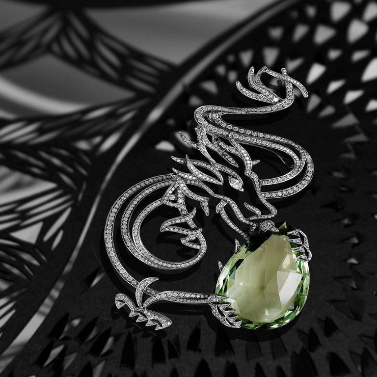 This Dragon Brooch is composed of a beautiful 55.39 cts Green Beryl. Lorenz Bäumer created this brooch as a celebration of nature, paved with white diamonds.