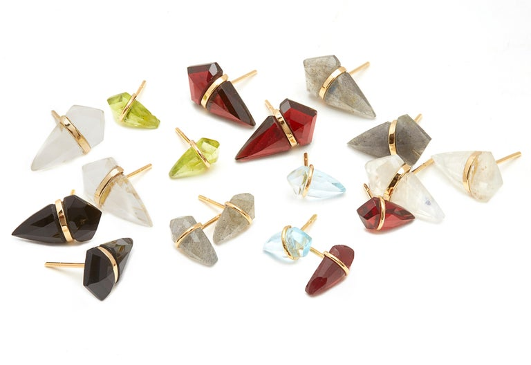 Custom cut laboradite kite stones wrapped in 18KT gold.  Signature look by NYC jewelry designer, Page Sargisson. Last picture of model is to show the size of the earrings.  It's the larger size in the group picture.