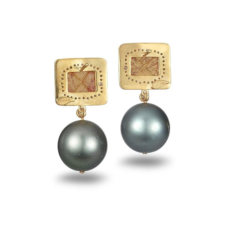 Hand made Coomi Affinity collection earrings set in 20K yellow gold with 7.50cts mandarin garnet, 47.08cts gray South Sea pearls, and 0.55cts diamonds.