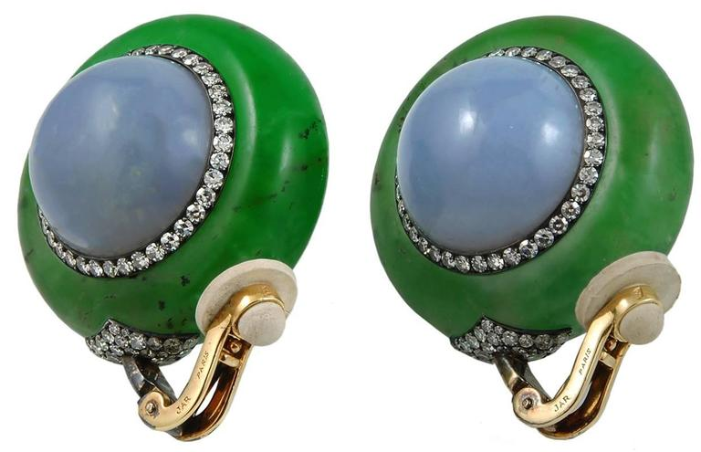 A chic & unusual pair of JAR earrings in silver and 18k gold; each designed as a circular chrysophrase ring, set on each side with a blue chalcedony cabochon with pavé-set single-cut diamond accents.  Signed JAR Paris.