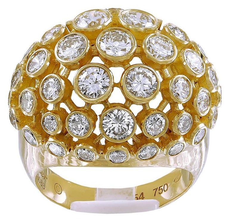 18k yellow gold set with round brilliant-cut diamond dome ring signed Cartier.   ring size 54