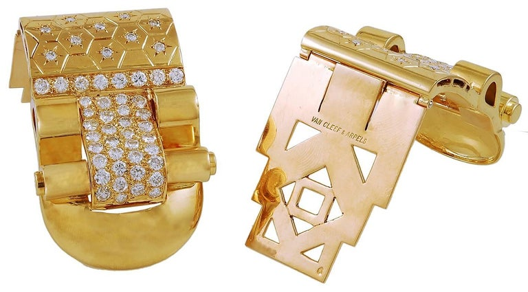 """These """"Ludo-Hexagone"""" French Retro 18 karat gold and diamond pair of double clips by Van Cleef & Arpels are comprised of 84 round brilliant cut diamonds in a honeycomb and etched star shaped arrangement finely set in 18k gold.  Signed Van Cleef &"""