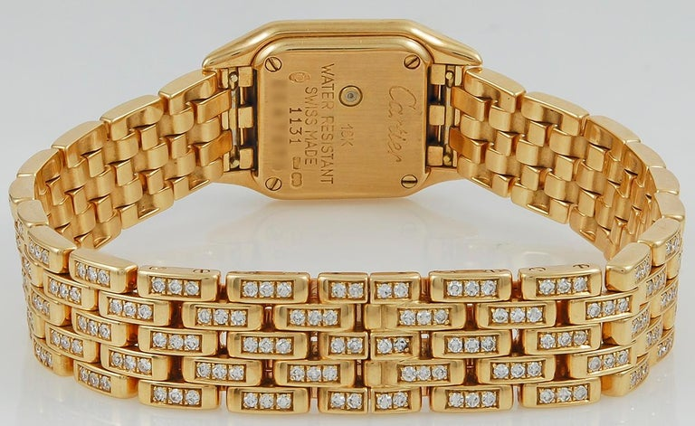 A classic timepiece of quartz movement by Cartier, this 18k yellow gold diamond mini-panthere watch with an interchangeable bracelet is designed with a square shaped dial surrounded by luminous rows of brilliant cut round diamonds set in yellow