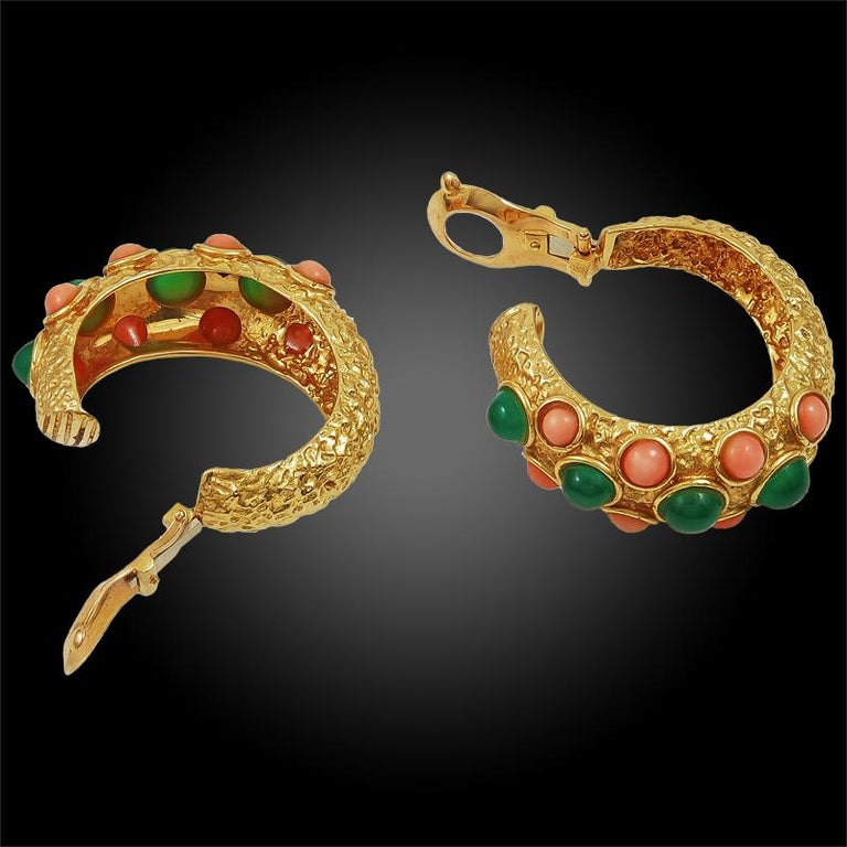 An exceptional suite by Van Cleef & Arpels that dates back to the 1970s, comprising an 18k yellow gold necklace, bracelet, and ear clips. The necklace is designed as an alternating series of cabochon cut coral and chrysoprase orbs separated by gold