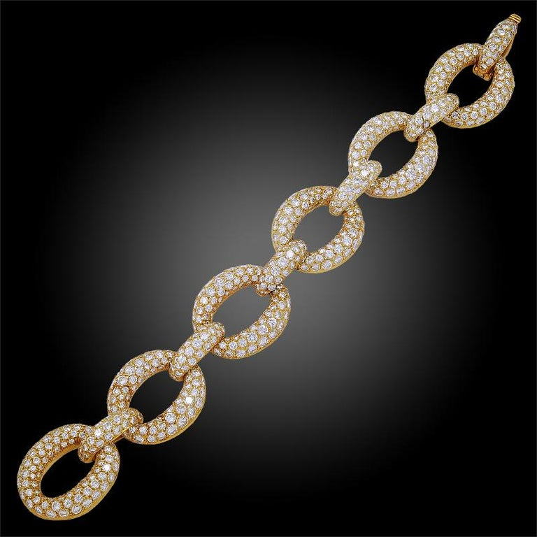 A brilliant piece that emits both style and timeless elegance comprising an 18k yellow gold large link bracelet by Van Cleef & Arpels, pavé set throughout with luminous brilliant-cut round diamonds weighing approximately 34 carats. Signed Van Cleef