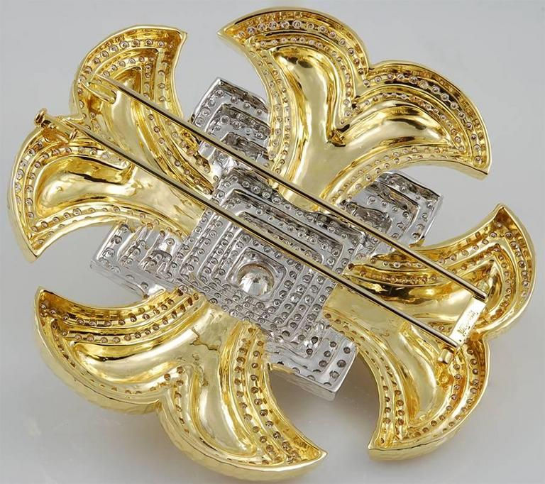 DAVID WEBB Maltese Cross Diamond Brooch in 18k Yellow Gold and Platinum.  An exquisitely textured gold design emblematic to David Webb, the Maltese Cross motif has been seen in various iterations throughout the years of the brand. The center of this