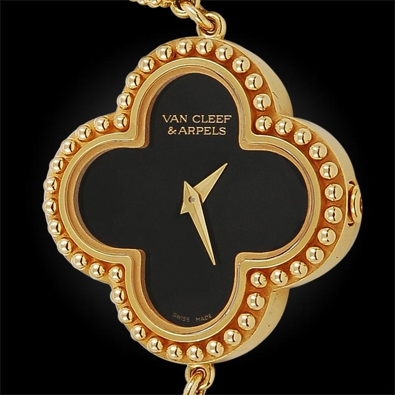 The Van Cleef & Arpels' Alhambra motif has become an iconic good luck symbol of the jewelry house. This quintessentially feminine Alhambra watch, adorned with onyx and 18k yellow gold, is a statement piece that emits class and sophistication,