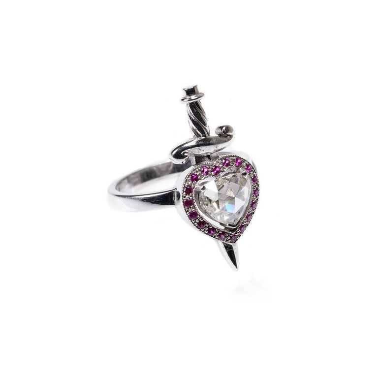 Contemporary 18kt White Gold, 0.70 Carat Diamond, 0.20 Carat Ruby, Heart & Dagger Ring For Sale