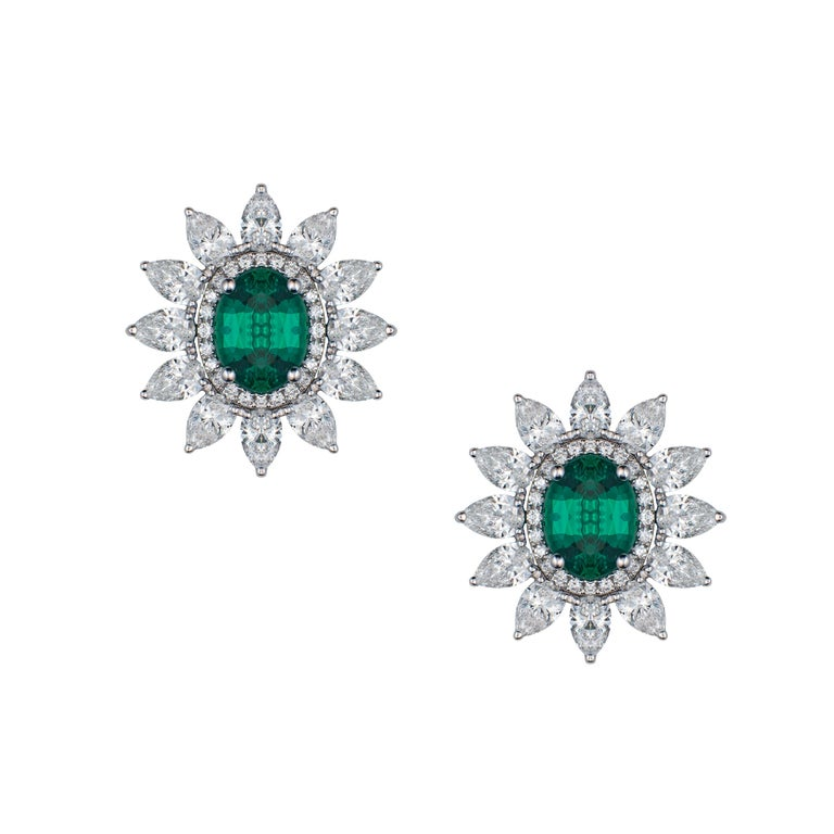 Emerald stud earrings with detachable pear-shaped diamond halo