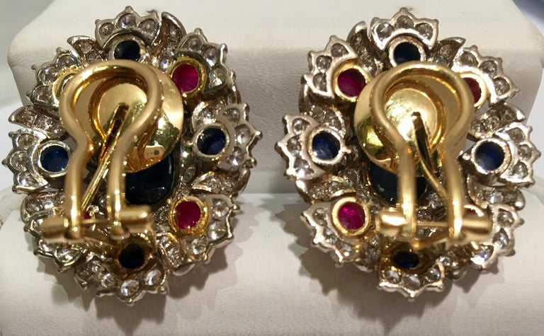 Contemporary Blue Sapphire, Ruby and Diamond Two-Tone Gold Earrings with Retractable Posts For Sale