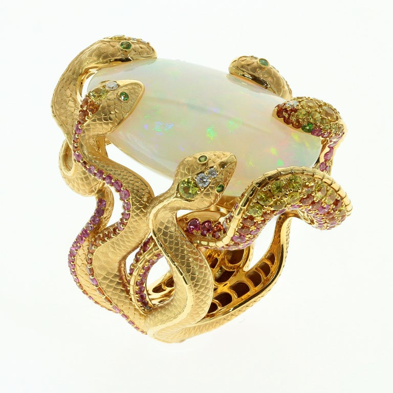 Contemporary 26.33 Carat Opal, 18 Karat Yellow Gold Snake Ring For Sale