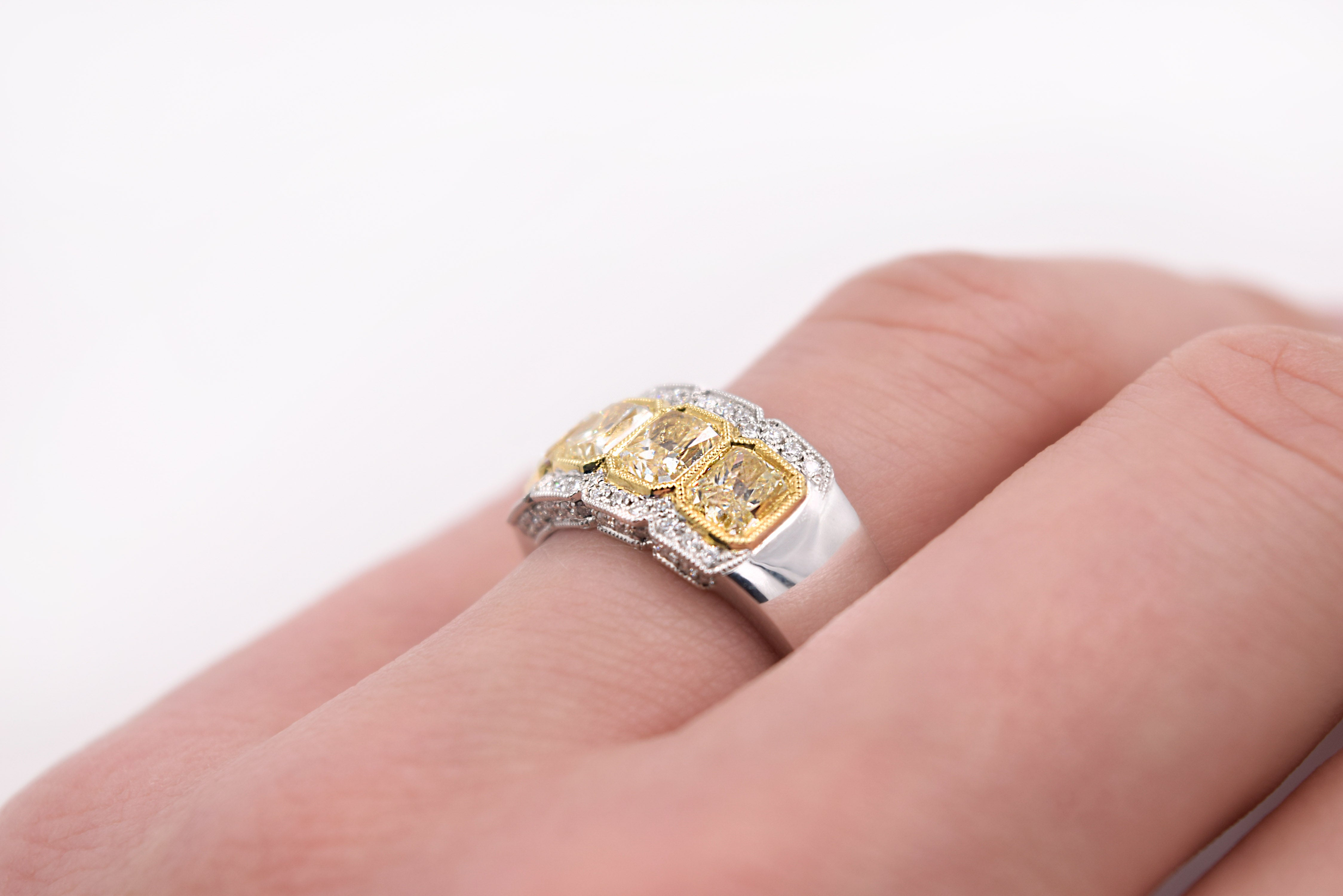 2.38 Carat Fancy Yellow Radiant Cut Four-Stone Diamond Ring in 18 ...