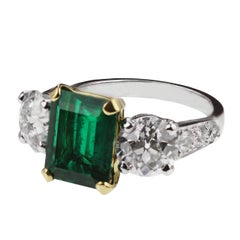 Emerald and Old European Cut Diamond Three-Stone Ring in Gold and Platinum