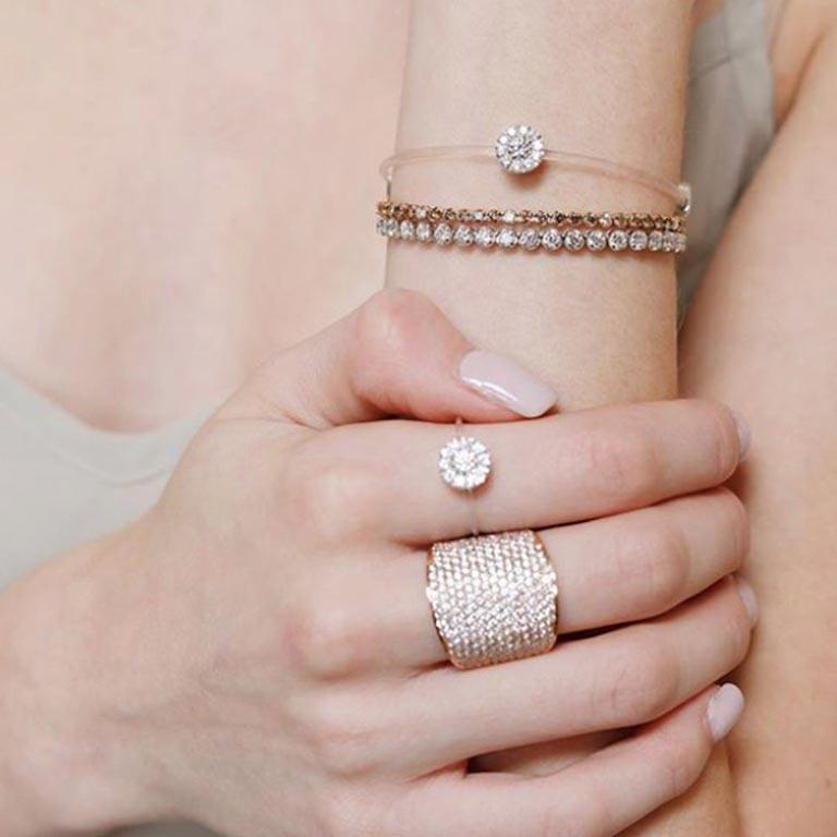 A collection of designs that are timeless and always sought season after season. Bracelets, rings, earrings and necklaces in white, yellow or rose gold adorned with white or black diamonds and at times with a dash of rubies. Worn stacked on their