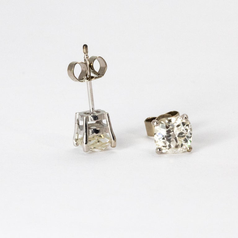 A classic pair of Art Deco diamond stud earrings. The earrings are set with a stunning white old European cut diamond weighing 95 points each, G colour and VS2 clarity. The stones are in a four claw setting and modelled throughout in 18 karat white