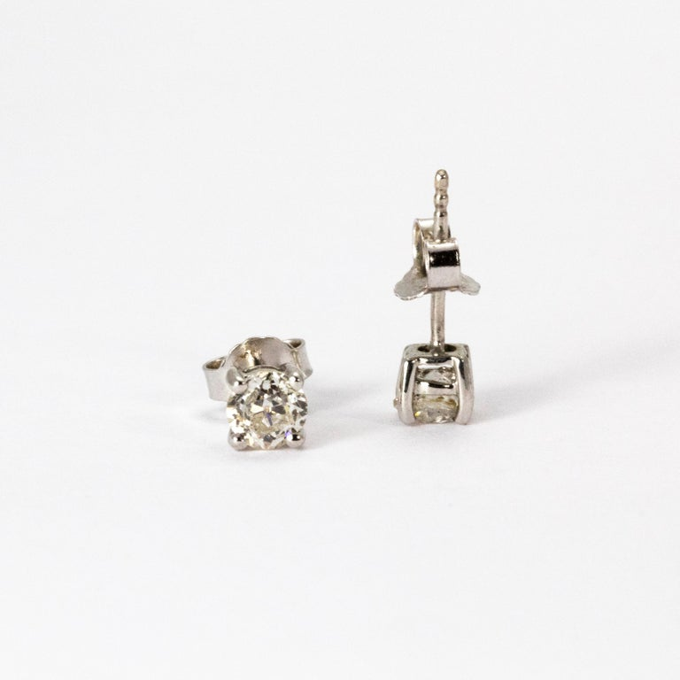 A pretty pair of Art Deco diamond stud earrings. Each earring hosts a brilliant white old European 35 point diamond, I colour and clarity SI2, in a classic four-claw setting. Modelled in 18 karat white gold.