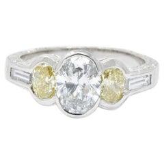 2.03 Carat Total Weight Oval Diamond Fancy Yellow Diamond Platinum Ring
