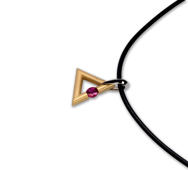 Modern Steven Kretchmer 18K Yellow Gold Logo Pendant with a Tension-Set 0.63ct. Ruby  For Sale