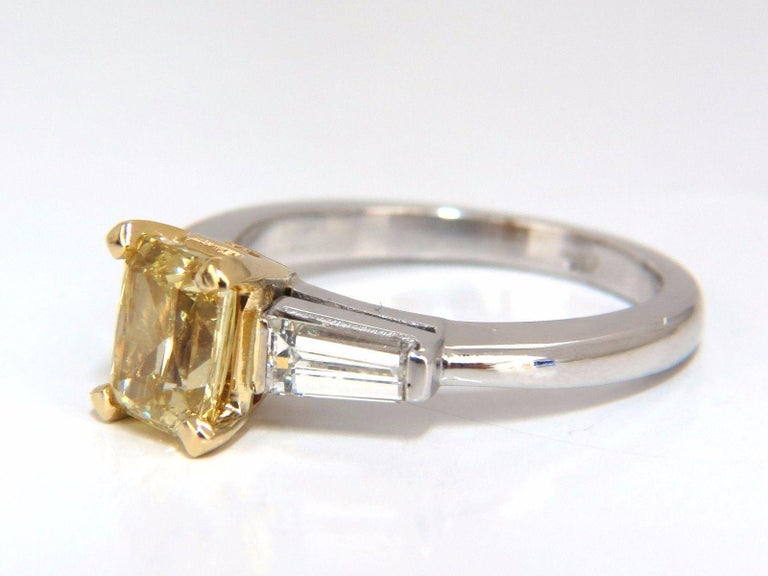 Radiant Yellow  GIA Certified 1.37ct radiant cut diamond ring.  Fancy Brownish yellow color  Si-1 clarity  Report Id: 2175348603  Please see attached photo for report.   .75ct. Baguette, full cut diamonds.  H Color Vs-2 clarity.  14kt white gold.  4