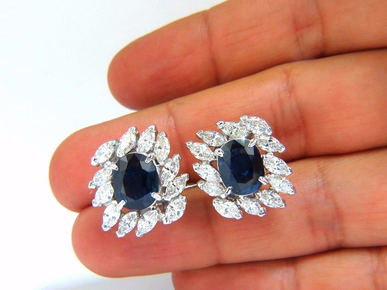 GIA Certified 3.74ct & 3.62Ct Natural Blue sapphire earrings.  Report # 2173124301  VS clean clarity / Transparent  Classic Royal Blue  10.25 X 8.15 X 4.73mm  10.30 X 8.02 X 4.32mm  3.80ct Side natural Marquise diamonds  G-color Vs-2 clarity.  Each